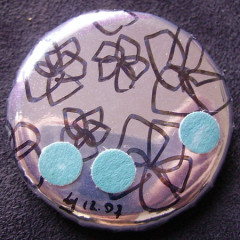 Badge Fleurs sur Miroirs