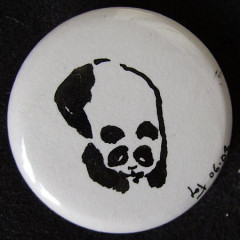 Badge Panda couché
