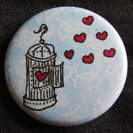 Badge «Les Amoureux» Cage à Oiseau