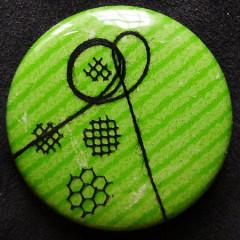 Badge Crépitement Noir sur Pomme