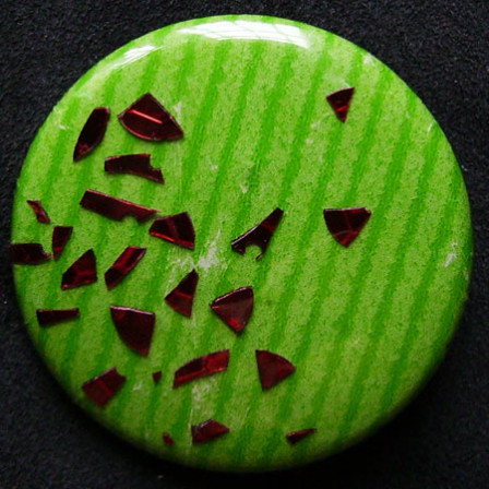 Badge Dispersion Rouge sur Pomme