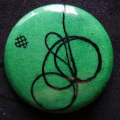 Badge Tournoiement Noir sur Vert