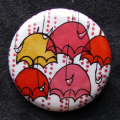 Badge Parapluies Camaieu Rouges