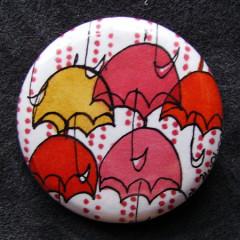 Badge Parapluies Camaieu Rouges