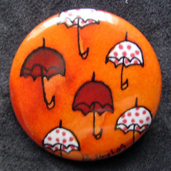 Badge Parapluies Orange et Pois