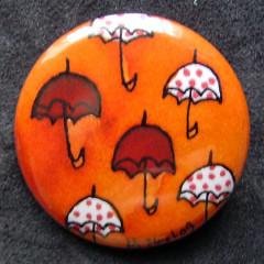 Badge Parapluies Orange et Pois
